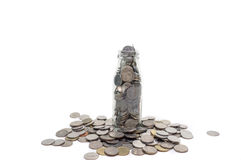 Saving money concept of collecting coins in glass bottle Isolate Royalty Free Stock Photos