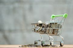 Saving money concept of collecting coins Thai money in a Shopping Cart on nature background.  as background business concept and. Saving concept with  copy Royalty Free Stock Image