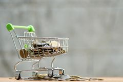 Saving money concept of collecting coins Thai money in a Shopping Cart on nature background.  as background business concept and. Saving concept with  copy Stock Photos