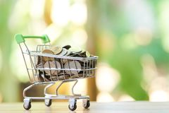 Saving money concept of collecting coins Thai money in a Shopping Cart on nature background.  as background business concept and. Saving concept with  copy Royalty Free Stock Photo
