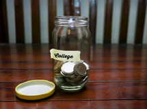 Saving Money Concept With College Text Written On Glass Jar.Selective Focus And Shallow DOF. Stock Photo