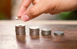 Saving money concept,Male hand putting money coin stack Royalty Free Stock Photography