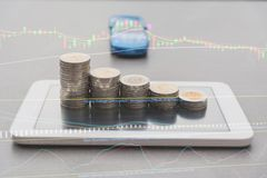 Saving money concept and money coin stack on smart phone. With toy car for growing business concept Royalty Free Stock Photography