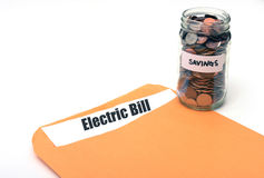 Saving money on electric or energy costs Stock Photos