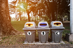 Saving money from the garbage and recycle trash. People can be making money trash when they drop momey or making money from recycle with garbage in the park Stock Photos
