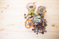 Saving money. Into glass jar for future investment Royalty Free Stock Photo