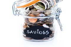 Saving money. Into glass jar for future investment Royalty Free Stock Photos