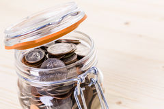 Saving money. Into glass jar for future investment royalty free stock images