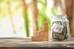 Saving money with hand putting coins in jar glass, save and investment money for prepare in the future royalty free stock photo