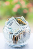 Saving money in jar with American dollors Royalty Free Stock Images