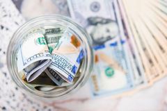 Saving money in jar with American dollors Royalty Free Stock Photography
