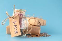 Saving money in jar Stock Photography