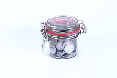 Saving money in  jar. Saving money concept - coins in  jars on white background Stock Image