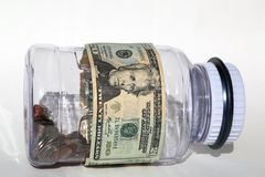 Saving money in the jar Stock Images