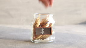 Saving money jar. Golden coins. stock video