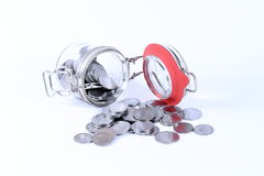 Saving money in  jar and surround. Saving money concept - coins in  jars on white background Royalty Free Stock Images