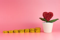 Saving Money for Love and Marriage on pink Stock Images