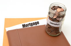 Saving money on mortgage or real estate Royalty Free Stock Photos