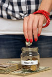 Saving money for new life Royalty Free Stock Image