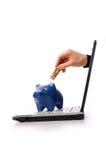 Saving money. Notebook with a piggy bank, saving money concept Stock Photo