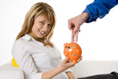 Saving Money in a Piggy Bank Royalty Free Stock Images