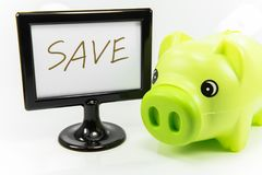 Saving money in a piggy bank for the future. Saving money in piggy pink pig to the future Royalty Free Stock Images