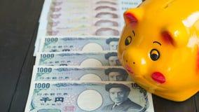 Saving money by Piggy Bank. Piggy bank , yellow pig piggy bank., Royalty Free Stock Image