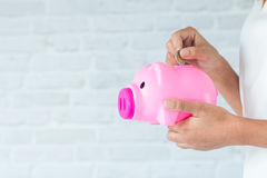 Saving money for piggy. Saving money for the future in a piggy bank Royalty Free Stock Photography