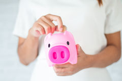 Saving money for piggy. Saving money for the future in a piggy bank Stock Photo
