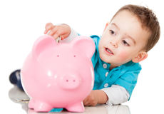 Saving money in a piggybank Stock Image