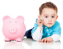 Saving money in a piggybank Royalty Free Stock Images