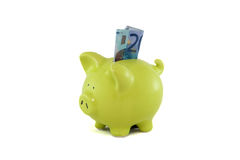 Saving money at the piggybank. Stock Images