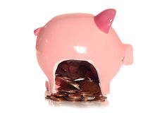 Saving money in a piggybank. Cutout Royalty Free Stock Photography