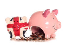 Saving money in a piggybank. Cutout Royalty Free Stock Images