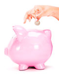 Saving money in a piggybank Stock Photography