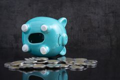 Saving money problem with empty piggy bank lay on dark black tab Royalty Free Stock Photos