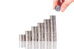 Saving money. putting coin growing in each columns Royalty Free Stock Photos