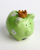 Saving money rules. A piggy bank with a crown to symbolize that saving money is the successful way ahead Stock Photography