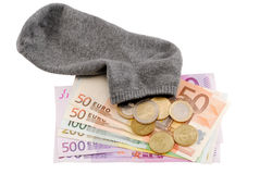 Saving money in the sock Royalty Free Stock Image