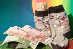 Saving money in socks Royalty Free Stock Images