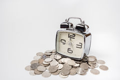 Saving money on time. And photo on white background Stock Photography