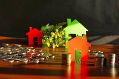 Saving money to buy house or home. Piggy bank with coins. Financial concept with Saving money to buy house or home. Piggy bank with coins stock photo