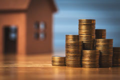 Saving money to buy a new home of its own money in the piggy bank. Lowest cost and tax. royalty free stock photos