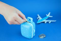 Saving money for travel on blue stock images