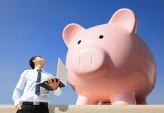 Saving Money With My Piggy Bank Royalty Free Stock Photo