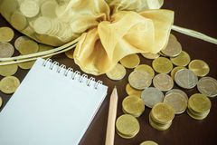 Saving money with writing income and expense Stock Images