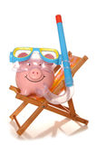 Saving money on your summer holiday piggy banks Stock Photo