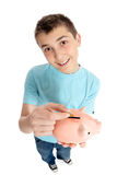 Saving pennies in a piggy bank Stock Images