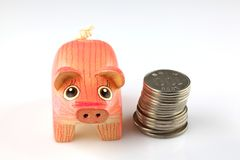 Saving pig and coins Royalty Free Stock Photo