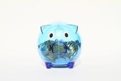 Saving pig half full of money Royalty Free Stock Photo